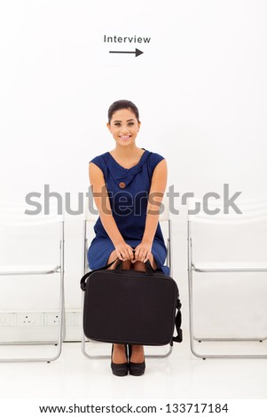 young female applicant waiting for job interview - stock photo
