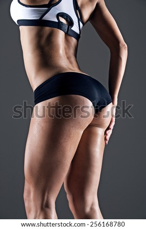 young female athlete back, trained buttocks, fit shape - stock photo