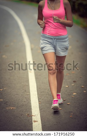 Young female athlete in park