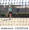 Young female athlete playing tennis in the court. Horizontal Shot. - stock photo