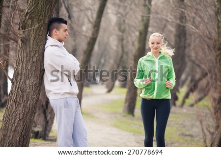 Young female athlete practicing in nature with her coach  - stock photo