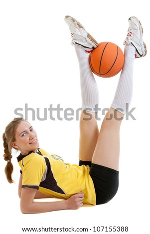 Young female basketball player with ball - stock photo