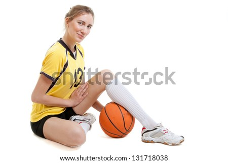 Young female basketball player with ball