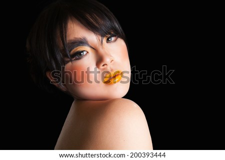 young female beauty shot with black background - stock photo