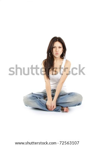 young female blowing a kiss against white yoga pose