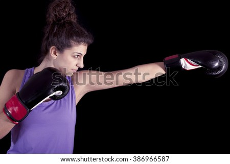 young female boxer hits during a workout