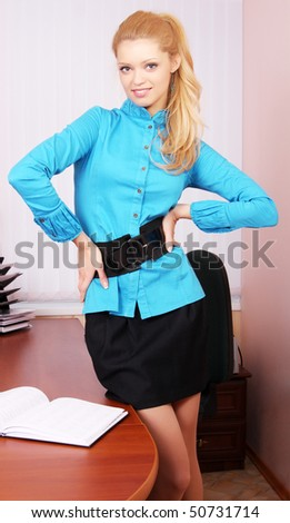 Young female business woman is working