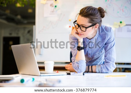 Young female businesswoman in the office - stock photo