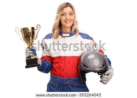 Young female car racing champion holding a gold trophy and looking at the camera isolated on white background