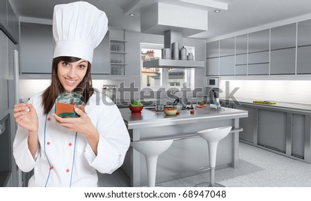 Young female chef with an open red spice pot