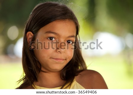 young female child face at the park