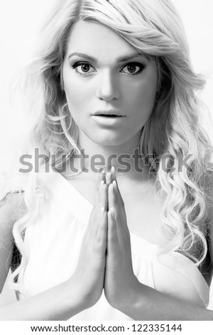 young female Christian praying,portrait ,high key - stock photo