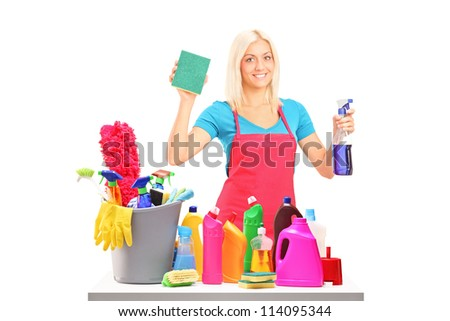 Young female cleaner with cleaning equipment isolated on white background - stock photo
