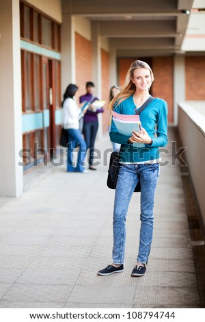 young female college student full length portrait - stock photo