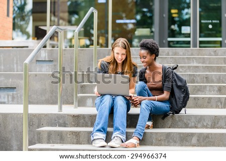 Young female college students - stock photo