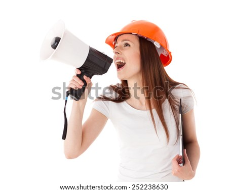 Young female construction superintendent with megaphone and clipboard on a white background. - stock photo