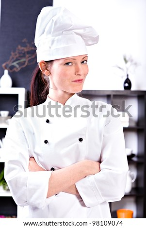 young female cook in the kitchen