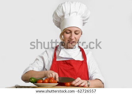 young female cook preparing vegetables