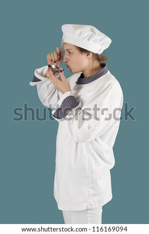 young female cook with soup ladle
