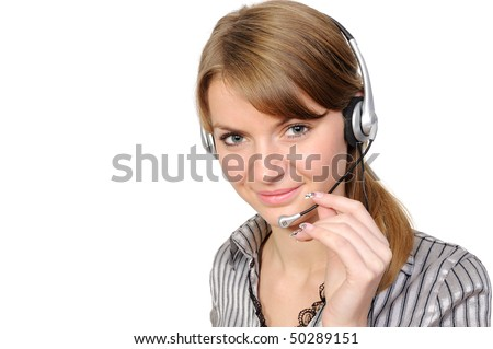 Young female customer service representative in headset, smiling  on a white background - stock photo