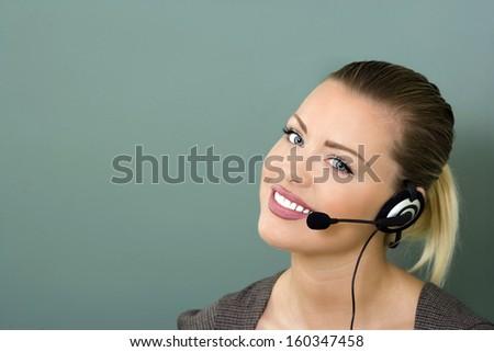 young female customer service representative smiling - stock photo
