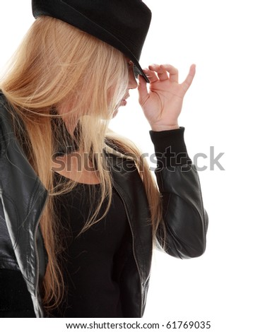 Young female dancer in black hat, isolated on white background