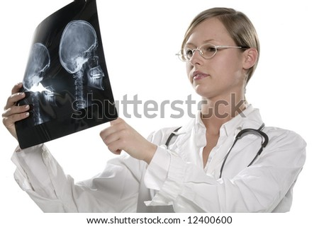 Young Female Doctor Examining MRI - stock photo