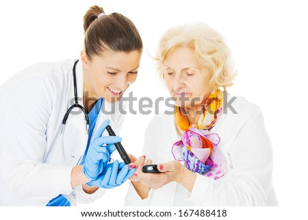 Young female doctor examining senior woman's blood sugar isolated over white background