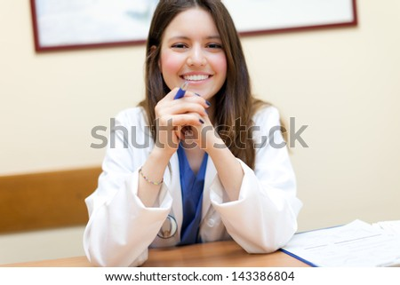 Young female doctor in her studio - stock photo