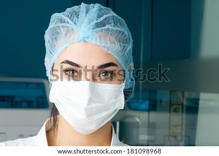 young female doctor in medical mask, close-up  - stock photo