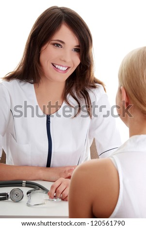 Young female doctor in office with female patient. - stock photo