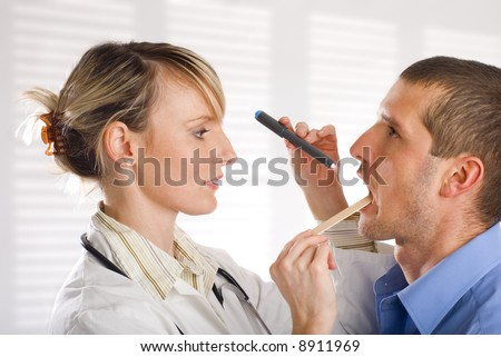 young female doctor looking at patient portrait - stock photo