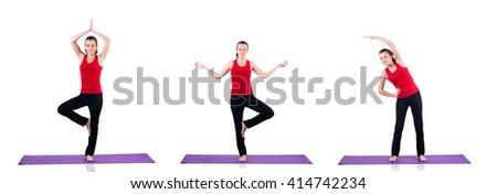 Young female doing exercises on white - stock photo