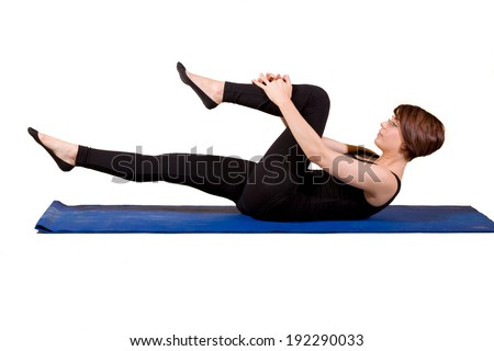 Young female doing Pilates