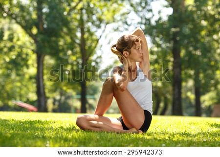 Young female doing yoga in nature.