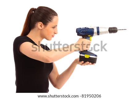 Young female dressed in black top holding a cordless electric drill on a white isolated background