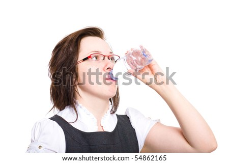 young female drinks still water from plastic bottle, studio shoot isolated on white background