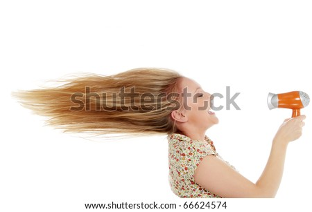 Young female drying hair , isolated on white - stock photo