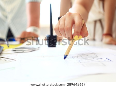 Young female engineer working in office