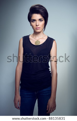 Young female fashion model posing for a studio shot - stock photo