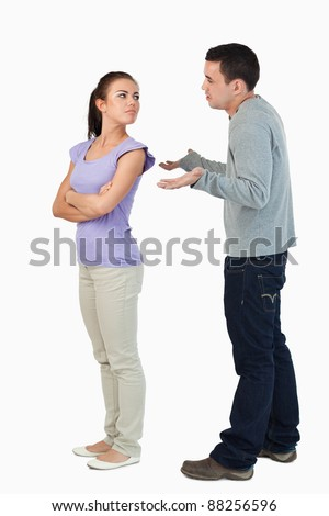 Young female freezing off her boyfriend against a white background - stock photo