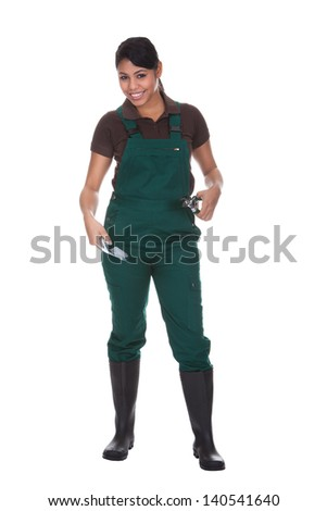 Young Female Gardner With Gardening Tools Isolated Over White Background