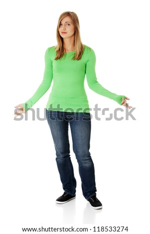 Young female gesturing do not know sign ,against white background - stock photo