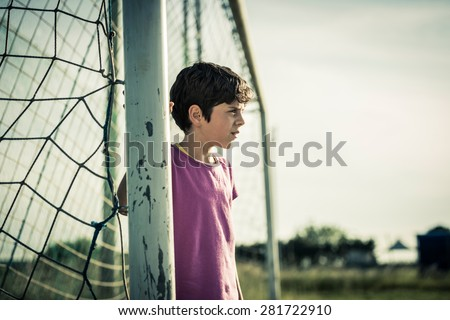 Young female goal keeper - stock photo