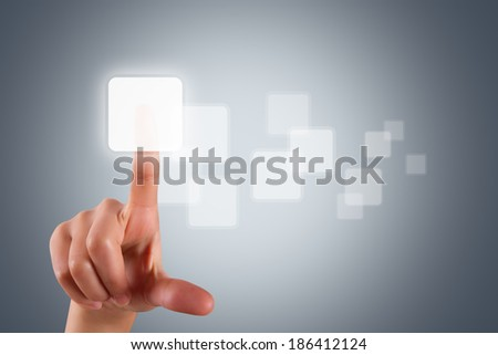Young female hand pressing or touching blank virtual modern buttons on digital screen interface. - stock photo