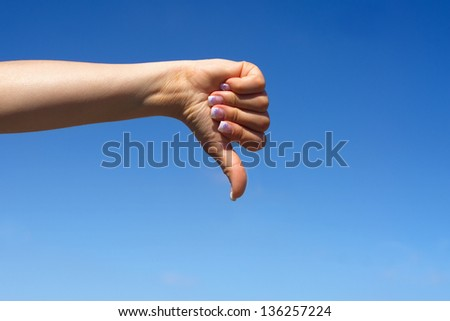 Young female hand shows thumbs down - stock photo