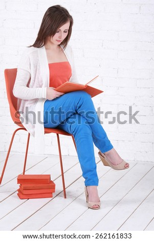 Young female happily reading book