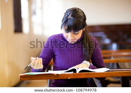 young female high school student studying in classroom - stock photo