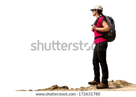 Young female hiker with backpack and boots standing on rock.Isolated on white background.  - stock photo