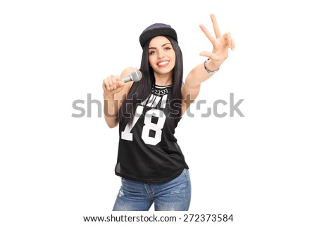 Young female hip-hop artist singing on a microphone and making a hand sign isolated on white background - stock photo